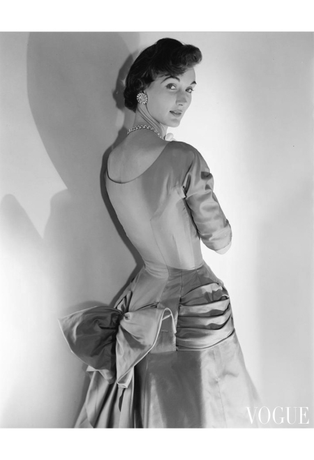Evelyn Tripp wearing a silk twill dress by Mollie Parnis Nav 1953