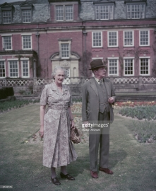 Former British prime minister Maurice Harold Macmillan (1894 - 1986) with his wife Dorothy in the grounds of Birch Grove House, their home in Chelwood Gate, Sussex