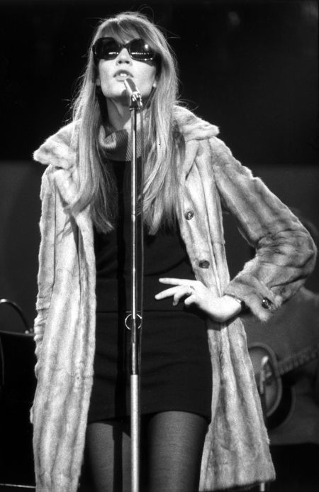 Francoise Hardy wearing sunglasses and a long fur coat during a performance, circa 1965. (Photo by Andrew Maclear:Hulton Archive:Getty Images)