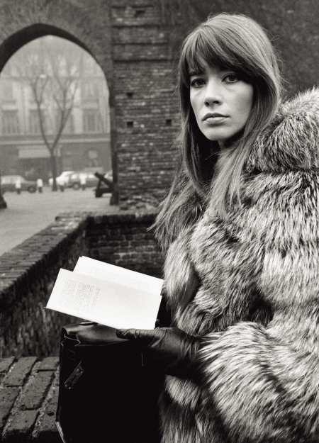 Francoise wearing a fur coat in Piazza Sant'Ambrogio. Milan, 1960s (Photo by Mondadori Portfolio via Getty Images)