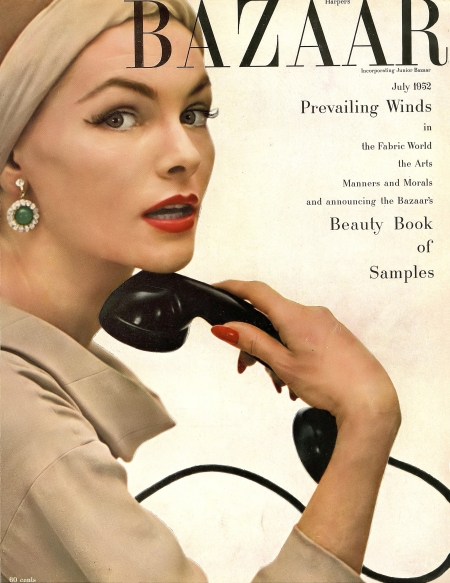 Georgia Hamilton in dress by Adele Simpson, hat by John Frederics, faux diamond and emerald earrings by Nettie Rosenstein , cover photo by Richard Avedon, Harper's Bazaar, July 1952
