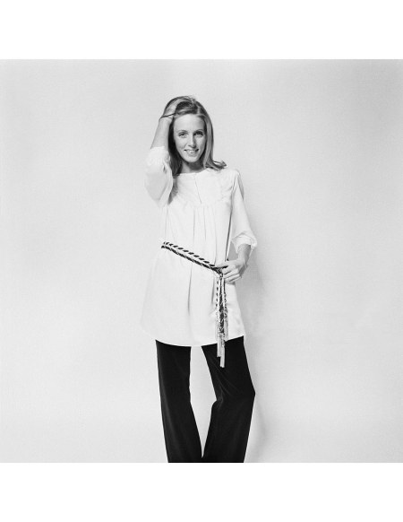 JJ wearing a satin-lisse blouse by Kayser with a frilled bib by Adrien Mann and black velvet trousers by Pierre Elegante, UK, 23rd September 1969