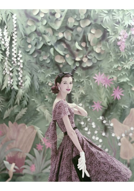 Joan Romano wearing a patterned Galanos dress with a tropical background 1956 © Richard Rutledge