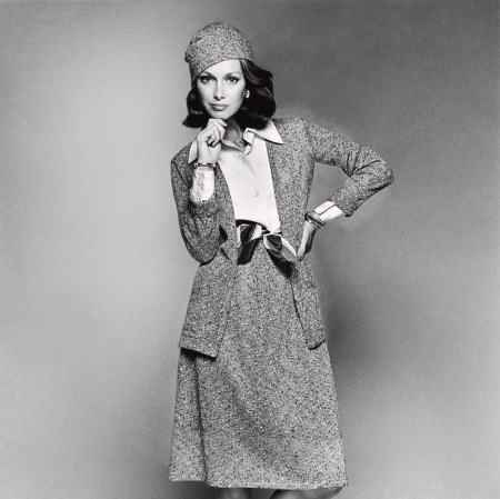 Karen Graham wearing a matching cardigan, skirt and hat by Chester Weinberg feb 1974