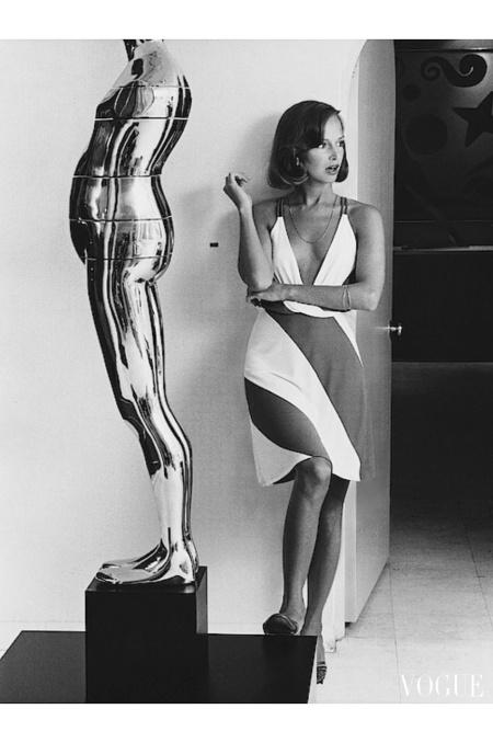 Karen Graham wearing a striped Neil Bieff dress by a Trova sculpture in the Hokin Gallery, Florida Sept 1973 © Kourken