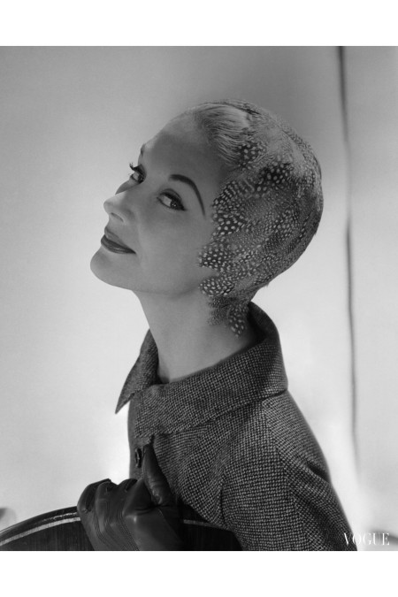 Lisa Fonssagrives-Penn modeling feathered sheath hat by Adolfo for Emme and tweed jacket by Ellen Kaye horst-p-horst-vogue-september-1954