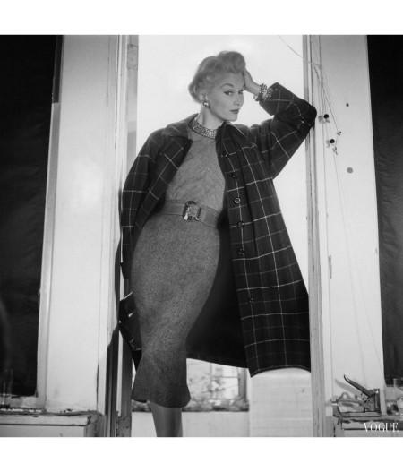 Lisa Fonssagrives-Penn modeling plaid greatcoat by Sherbrooke over shirt and skirt with belt horst-p-horst-vogue-september-1953