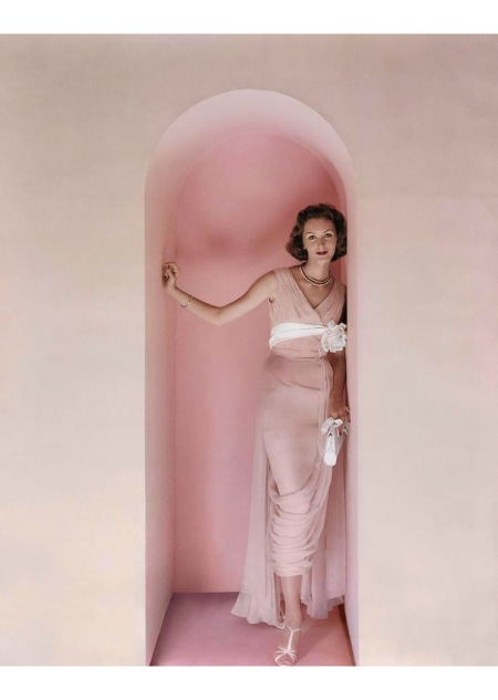 Lucinda Hollingsworth wearing a pink Edward Abbott dress in an archway Nov 1956 © Richard Rutledge