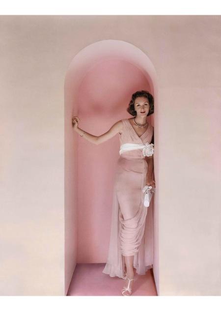 Lucinda Hollingsworth wearing a pink Edward Abbott dress in an archway Nov 1956 © Richard Rutledge