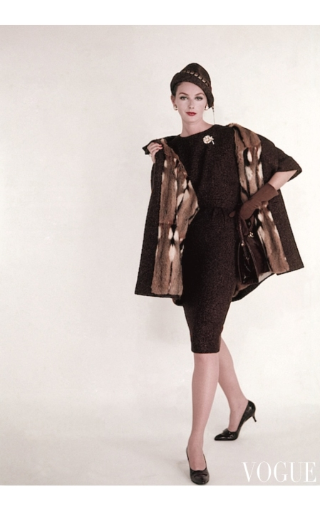 Lucinda Hollingsworth wearing tweed dress under fur lined coat with a Lucille purse and Van Cleef brooch Aug 1959 © Karen Radkai
