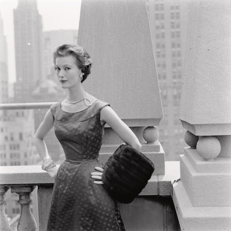 Mary Jane Russell standing against a rooftop column in a Vogue Pattern S-4446 evening dress Vogue Sept 1953 © Richard Rutledge