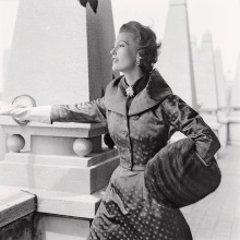 Mary Jane Russell standing against a rooftop column in a Vogue Pattern S-4446 jacketed evening ensemble Sept 1953 © Richard Rutledge