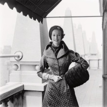 Mary Jane Russell standing against a rooftop column in a Vogue Pattern S-4446 jacketed evening ensemble