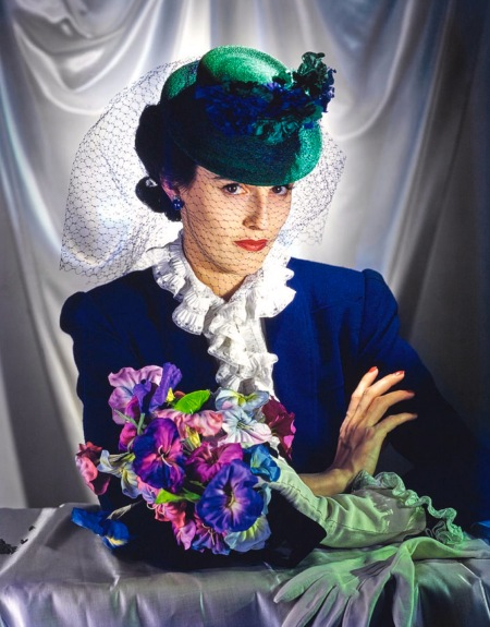 Miss Barbara Cushing, later known as Babe Paley, with bouquet of flowers, wearing blue wool suit with ruffled collar, and green hat with veil Mar 1940 © Toni Frissell