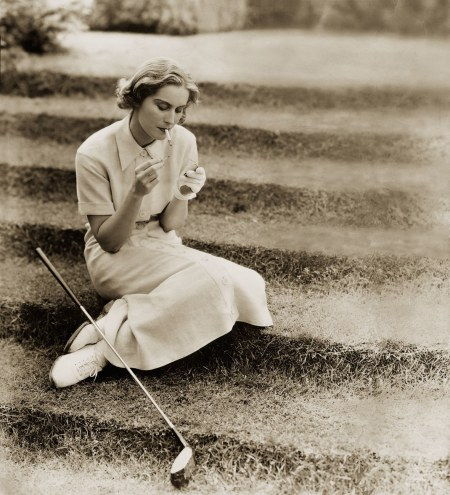 model Elizabeth Blair wears a smart, pressed white golfing suit from 1934 linen dress, leather golf glove, and lace-up golf shoes that would inform the style of a ladies_ oxford © Ton