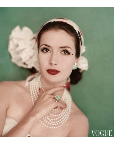 Model Gitta Schilling wearing silk chiffon headband and pearls june 1959