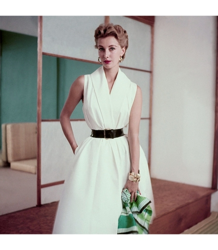 Model in a white cotton dress and holding a scarf Glamour June 1952