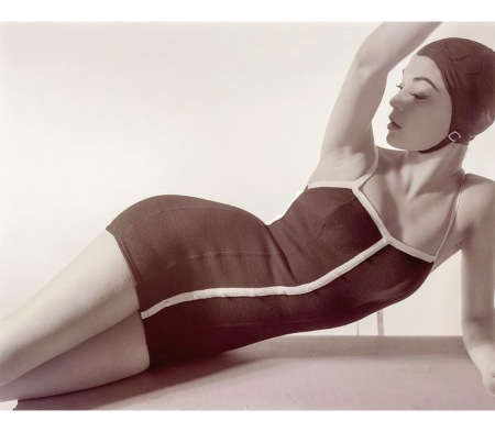 Model Jean Patchett lying down wearing a Sacony swimsuit with a cap Jan 1954 © Horst P.Horst