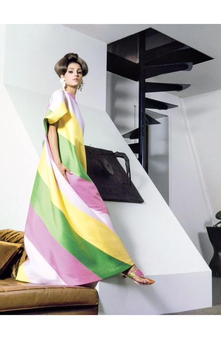 model poses in Bennett_s apartment at the Dakota A model wearing a yellow, pink, green and white striped burnoose by Luci Ann Vogue Nov 1964 © Horst P. Horst b