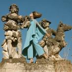 Model standing between statues at the Villa Palagonia, Bagheria, Sicily dec 1967 copia