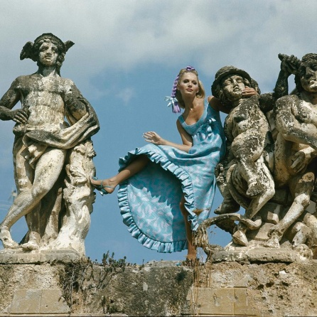 Model standing between statues at the Villa Palagonia, Bagheria, Sicily Dec 1967