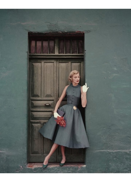 model standing in a doorway wearing a dress by Heatherlane May 1955 © Leombruno - Bodi