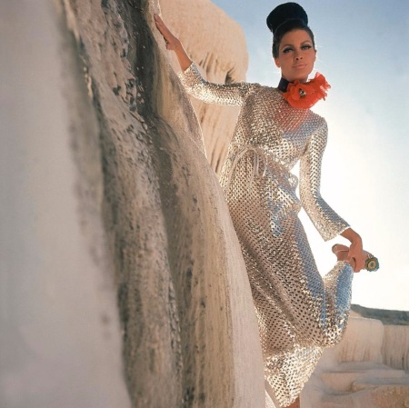 Model wearing a long-sleeved, full-length silver sequined dress by Anne Fogarty dec 1966