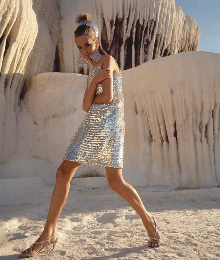 Model wearing a short silver sequined dress by Joan Arkin