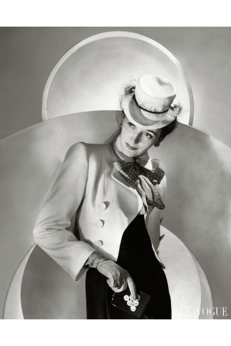 Model wearing a white wool sea-dog jacket with red cravat by Vera Maxwell horst-p-horst-vogue-april-1942