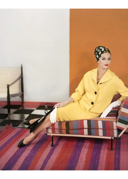 Model wearing a yellow suit from Vogue pattern S-4867 march 1958