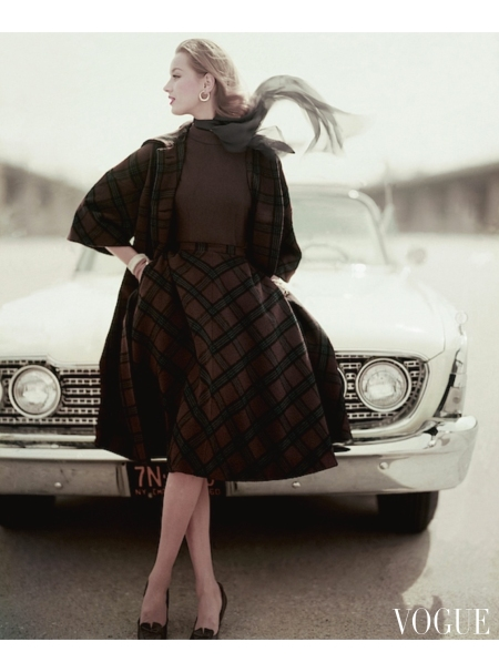 Model wearing plaid suit by Bud Kilpatrick and leaning against a Ford Sunliner July 1960 © Karen Radkai