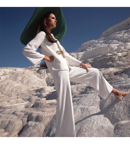 Model wearing white crepe pants and shirt by Ellen Brooke for Sportswear Couture Dec 1966