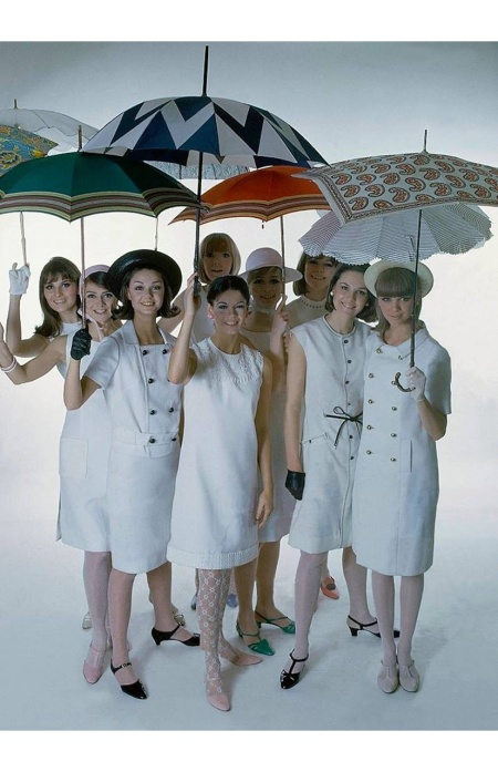 Models in various white dresses with various colored parasols Glamour Magazine, May 1965 © William Connors