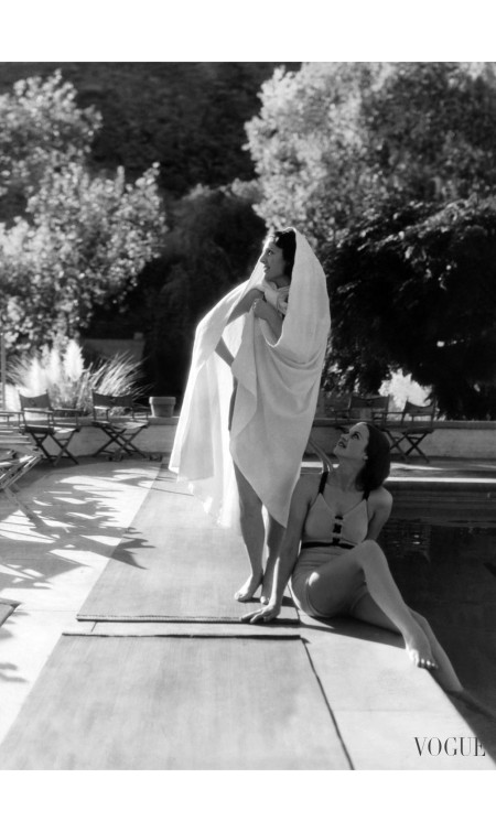 Models wearing (from left) a white terry cloth Bedouin cape; and a knit swimming suit that laces up the front by Jantzen horst-p-horst-vogue-january-1936