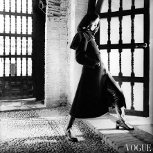 Moyra Swann stands in the El Mexuar room in the Alhambra, Spain wearing a coat oct 1968