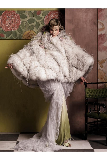 Nina Ricci silver fox cape with ostrich feathers, dégradé bias-cut silk dress, and shoes. Fred Leighton earrings