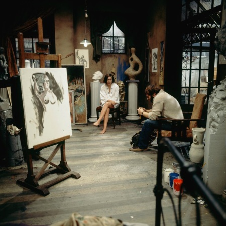 Painter in studio with model