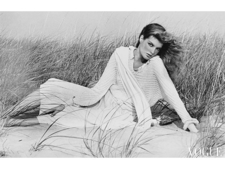 Rene Russo wearing a sweater and skirt by Eleanor Brenner on sand dunes nov 1977