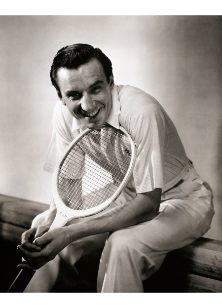 Tennis ace Fred Perry, winner of three consecutive Wimbledon titles in the mid-1930s, posed for a 1934 issue of Vanity Fair in a polo and white pants © Anton Bruehl