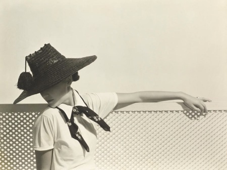 Toto Koopman wearing shiny dark straw hat with tassel by Agnes Jan 1935