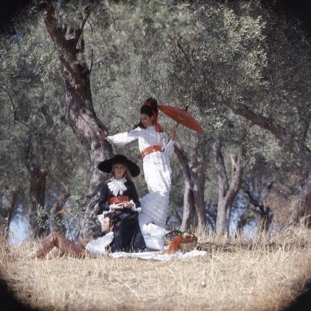 Two models wearing Bill Blass dresses in an olive grove dec 1967