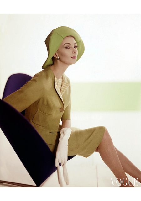 Wilhelmina sitting on a George Tanier chair wearing a green suit april 1962