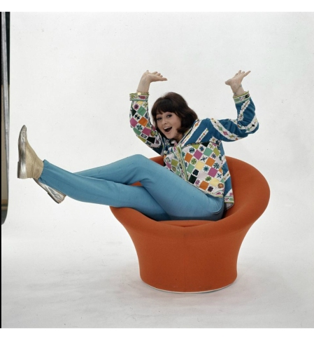 woman iin Orange chair in the sixties