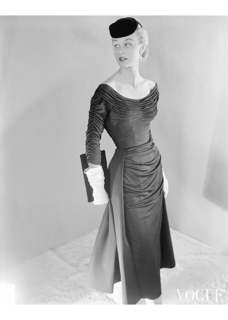 A model wearing a rayon matte jersey dress by Ceil Chapman Nov 1953