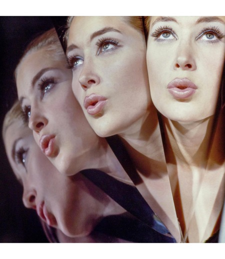 A model's face repeated four times in mirrored reflection Vogue Nov 1964 © John Rawlings