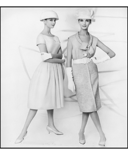 Anna Carin Bjork (l) in beige broadcloth dress by Abe Schrader, Simone in textured gray and white tweed sheath with white leather belt by Nathan Strong, hats by Dior-New York, photo by L