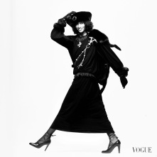 Model, Beverly Johnson, wearing a black silk jersey dress, by St. Laurent, with a black fox fur over her back, held on by a jewel studded chain, and a large black Cossack hat, with black gloves on hands *** Local Caption *** Beverly Johnson;