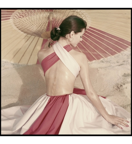 Carla Marlier in criss-cross backless dress by Robert Sloane, hoop earrings by Tiffany & Co., photo by Frances McLaughlin-Gill, Glamour, April 1, 1960 © Frances McLaughlin-Gill