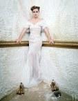 Emma Watson wears a gown by Oscar de la Renta