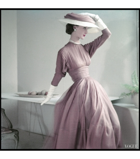 Evelyn Tripp wearing fascia dress in fawn silk muslin, white gloves, and matching hat, photo by Frances McLaughlin-Gill, Vogue March 1952
